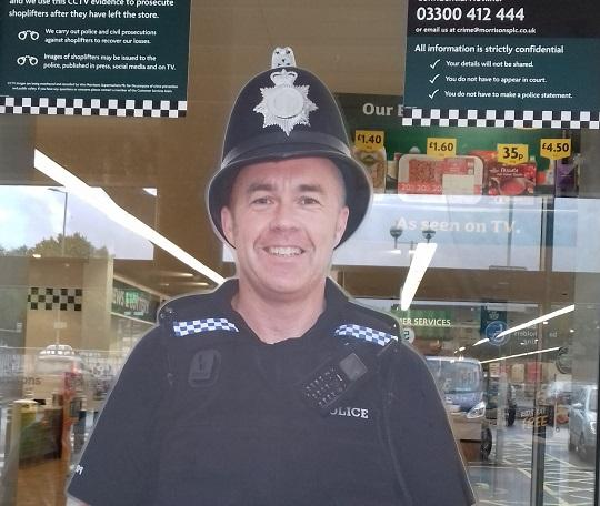 The 'police officer' on duty at a local supermarket.