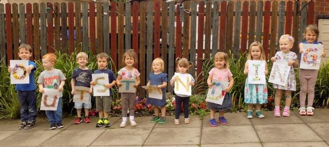 Children at Busy Bees nursery celebrating an 'Outstanding' rating. Photo: Busy Bees nursery