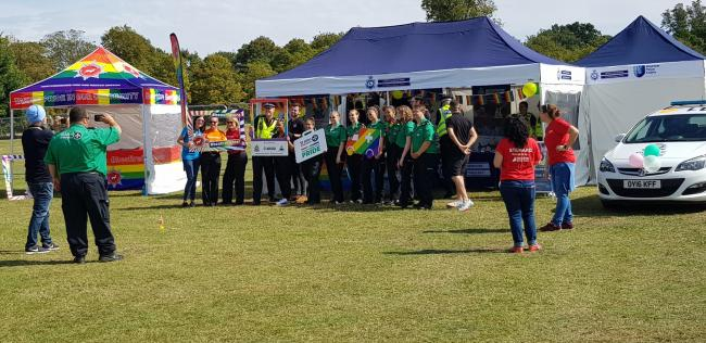 The various groups get ready for the festivities at Herts Pride 2019. Credit: James Cowen.