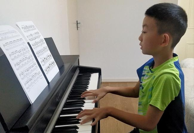 Haosei Du was impressively awarded a distinction with Grade 5 piano at just 9-years-old.