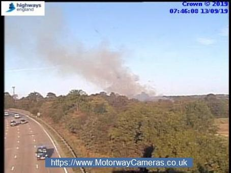 Smoke seen from a camera on the M25. Credit: Highways England