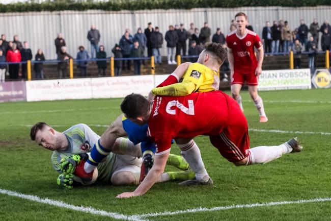 Joe Iaciofano gets caught in a goal-mouth scramble against Welling United. Picture: Leigh Page