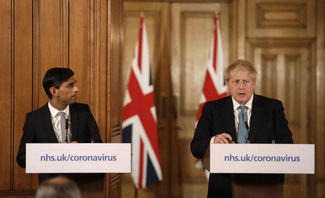 Chancellor Rishi Sunak with Prime Minister Boris Johnson at a media briefing in Downing Street, Photo: Matt Dunham/PA Wire