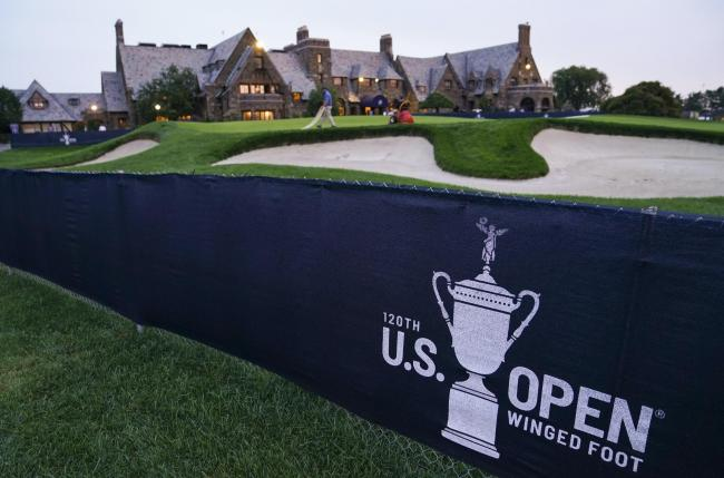 A green is prepared by the grounds crew outside the clubhouse ahead of the US Open at Winged Foot