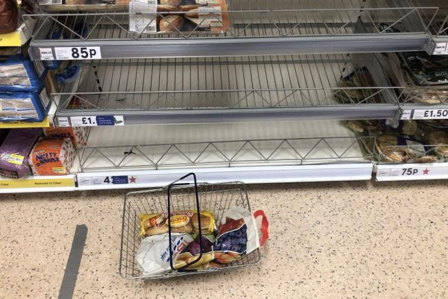Empty food shelves at a Tesco store in Banbridge, Northern Ireland