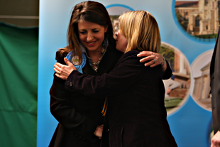 Tory Annie Brewster is congratulated by Lib Dem candidate Judy Shardlow.