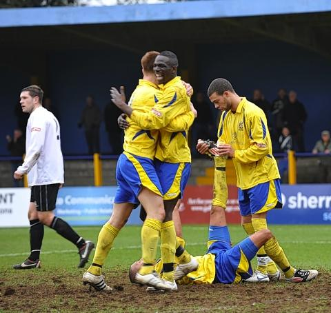 Sakho Bakare and Simon Martin celebrate during the Saints' win over Bashley: Robert Walkley