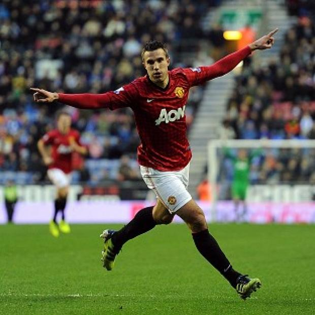 Robin van Persie celebrates scoring Manchester United's second goal against Wigan