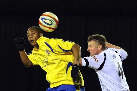 Greg Ngoyi heads towards goal in the Saints' defeat to Cambridge City: Leigh Page