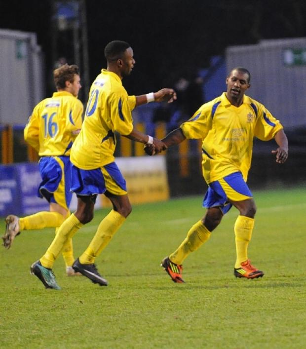 St Albans & Harpenden Review: Chris Henry and Jerome Walker celebrate the Saints' equaliser against Hitchin Town: Robert Walkley