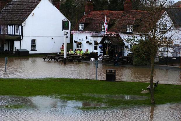 St Albans & Harpenden Review: Pub goers make do during the flood