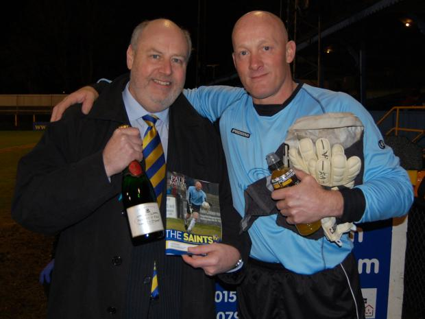 St Albans & Harpenden Review: Paul Bastock is presented with a bottle of champagne by chairman Nick Archer on his 300th game for the Saints. Picture: David Tavener