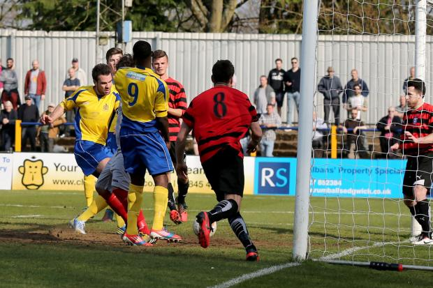 St Albans & Harpenden Review: City captain Ben Martin tucks away a 19th minute equaliser. Picture: Leigh Page