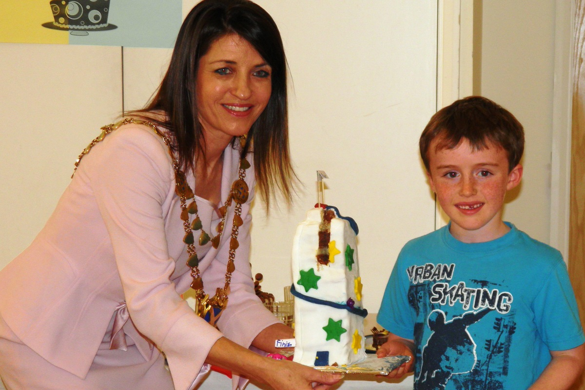 Six-year-old Luke Comiskey with his Helter Skelter cake