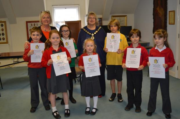 Prize winners are pictured along with Mayor of Harpenden Rosemary Farmer and deputy head of the Grove Infant and Nursery School, Sara Prince, who organised the competition