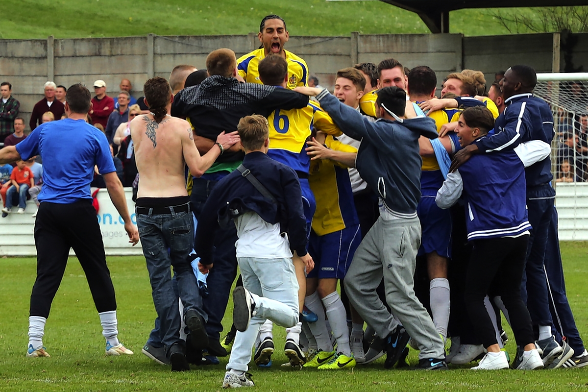 St Albans City fans celebrated on the pitch with the players after winning promotion: Dave Peters