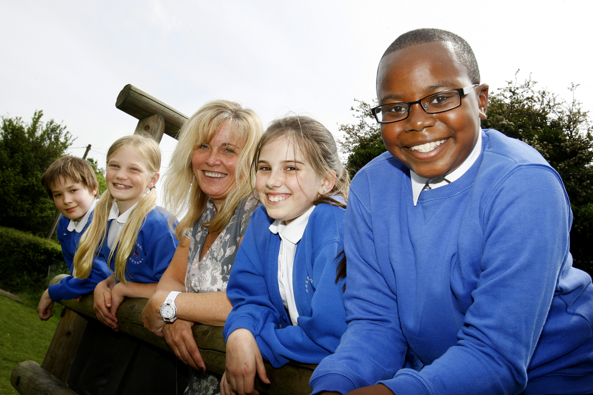 Sandridge Primary School Head Mrs Impey with pupils (left to right) Dylan Stanton 11, Harriet Goodman 9 Francesca Hayes 10 & Max Abimbola 11 (at front)