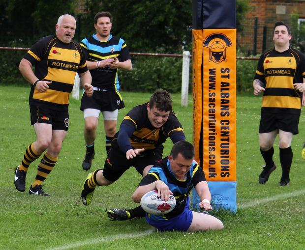 Iain Langley scores for St Albans in their Merit League game