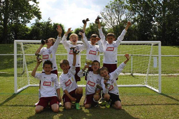 Wheathampstead Wanderers celebrate their trophy defence