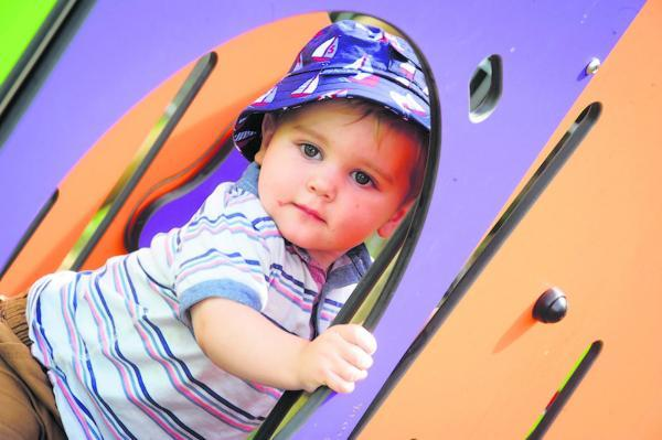 Logan Bromwich, 15 months, enjoys the new toddler playground at Porters Hill, Harpenden. Picture by Simon Jacobs.