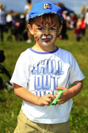 Jack, aged two, enjoys face painting at the festival