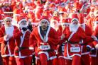 People dressed as Santa Claus at the start of the London Santa Dash at Clapham Common