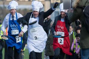 In video: MPs beat Peers and journalists in pancake race