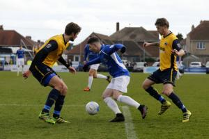 Jamie Cureton is crowded out during Saturday's loss to Gosport Borough. Picture: Leigh Page