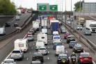 Queuing traffic on a motorway, as traffic is expected to peak ahead of the Easter weekend (Gareth Fuller/PA)