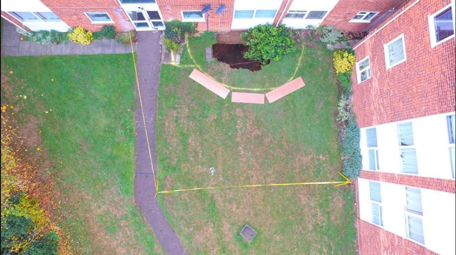 An aerial view of the sinkhole in St Albans. Credit: @HFRS
