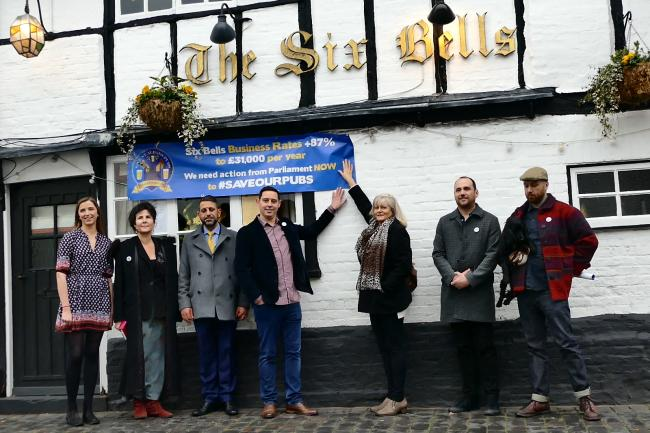 Landlords and CAMRA pictured with Anne Main outside The Six Bells. Picture: Eat Life Productions - Ruth Tidmarsh
