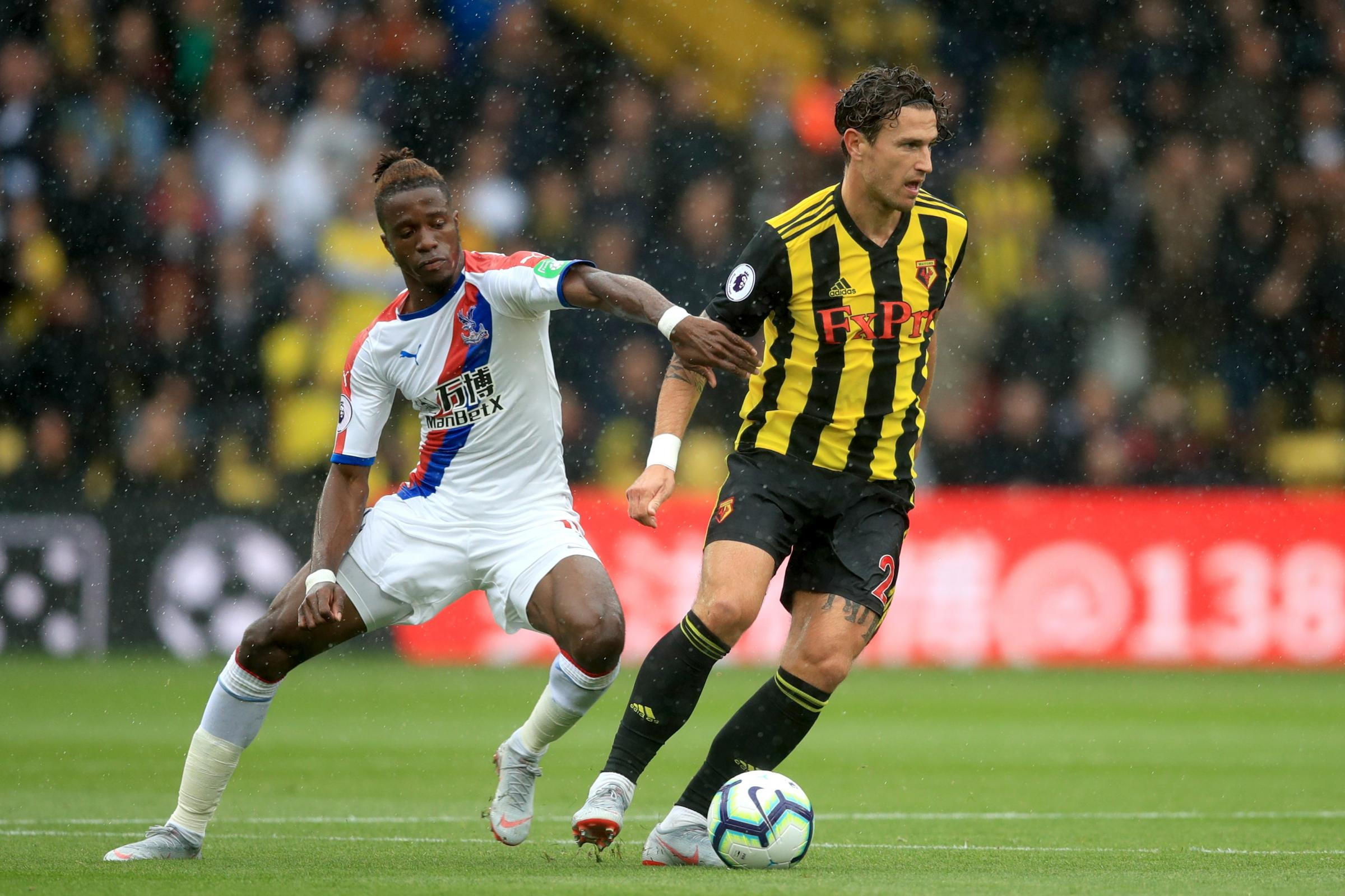 Crystal Palace's Wilfried Zaha (left) came in for some rough treatment against Watford earlier in the season
