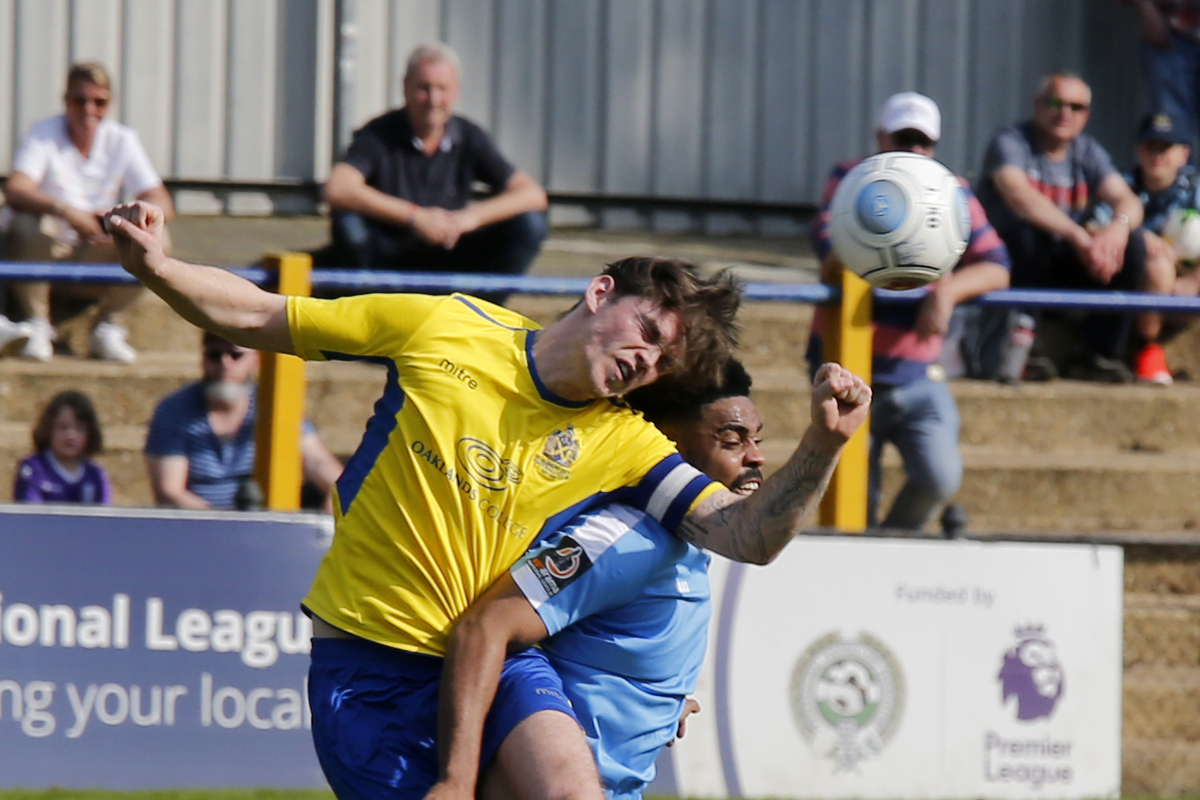 Tom Bender wins an aerial contest during Friday's win over East Thurrock United. Picture: Leigh Page